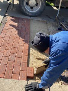 Greg Price laying bricks